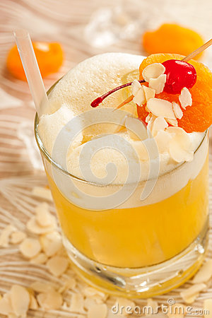 Yellow drink with almonds