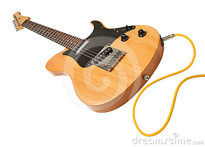 Yellow electric guitar with a cable plugged