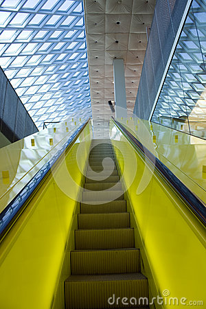 Yellow Escalator and blue roof