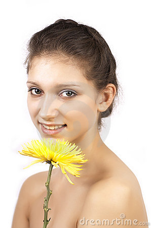 Yellow flower and smiling woman