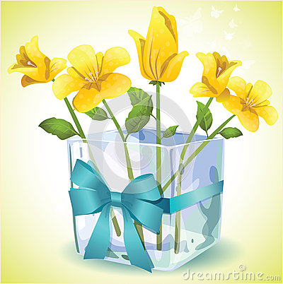 Yellow flowers in a square glass vase