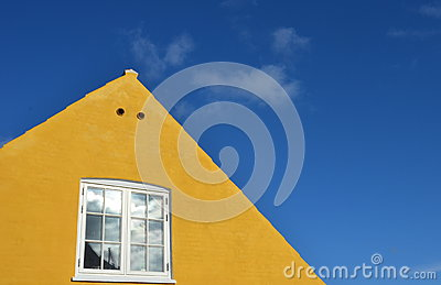 Yellow gable with white window