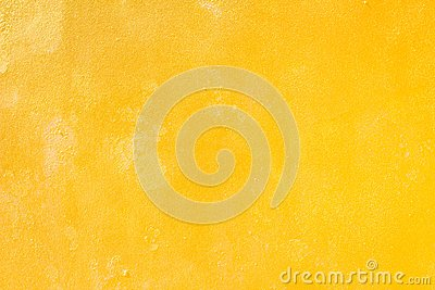 Yellow grunge cement wall, textured background Stock Photo