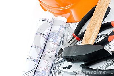 Yellow hard hat and working tools