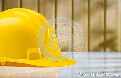 Yellow helmet on white table