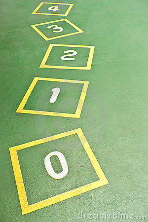 Yellow Hopscotch on Green Playground