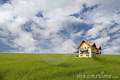Yellow house on grass field