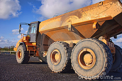 Yellow industrial heavy earth loader outside