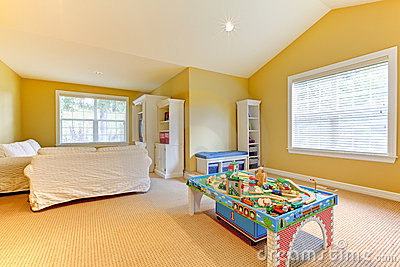 Yellow kids play room with white sofa.