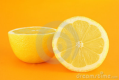 Yellow lemon on orange backgro