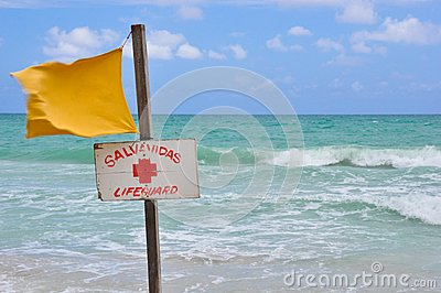 Yellow life saving flag at the beach