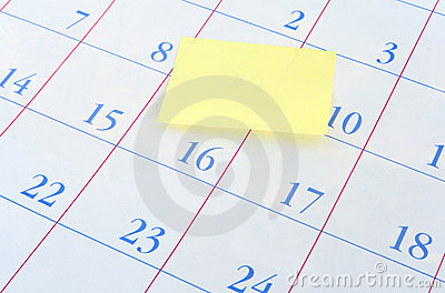 Yellow memo note on a calendar