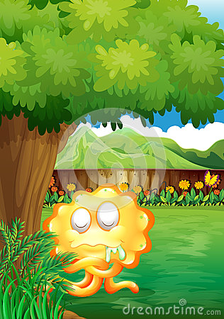 A yellow monster under the tree in the gated yard