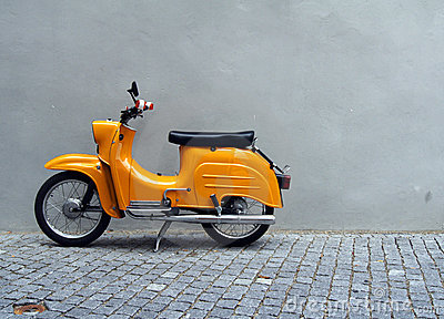 Yellow Motorbike by Grey Wall