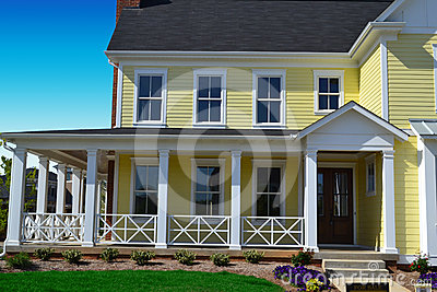 Yellow new england style home with porch royalty free for New england style homes