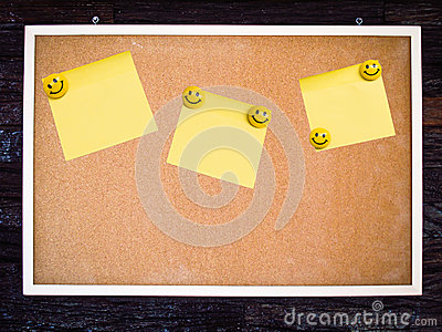 Yellow note pad on blank board