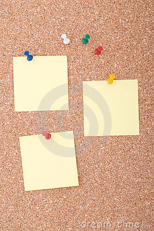 Yellow Note Papers With Tacks On Cork Surface