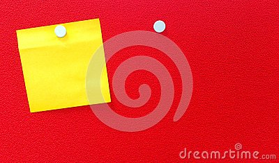 Yellow notepad on red wall