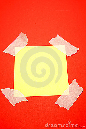 Yellow paper taped to red