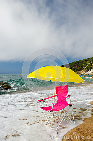 Free Yellow Parasol And Pink Chair At The Beach Stock Photography - 30805152