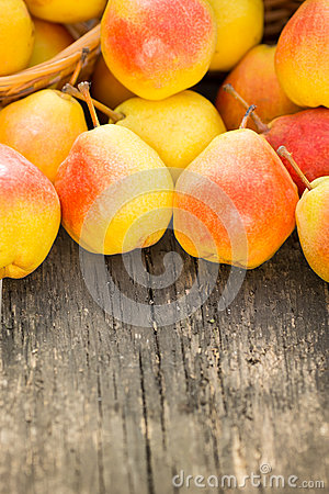 Yellow pears on wooden table