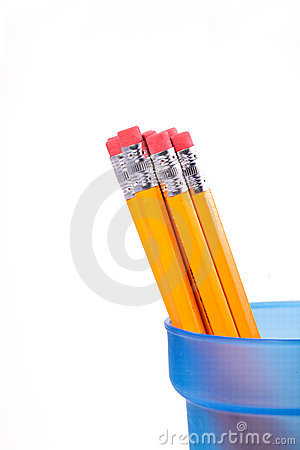 Yellow pencils in a blue cup.