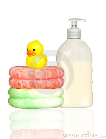 Yellow plastic duck over sponges and boat bath dis