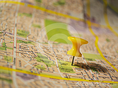 Yellow pushpin on a map