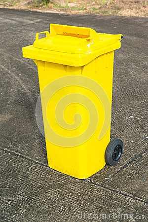Yellow recycle bin