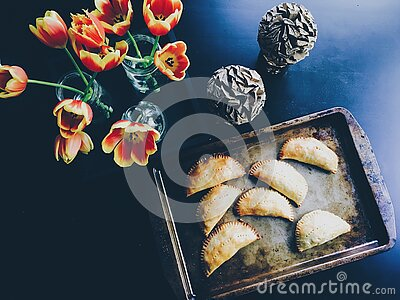 Yellow And Red Flower On Clear Glass Flower Vase Beside Brown Steel Tray With Pastry Free Public Domain Cc0 Image