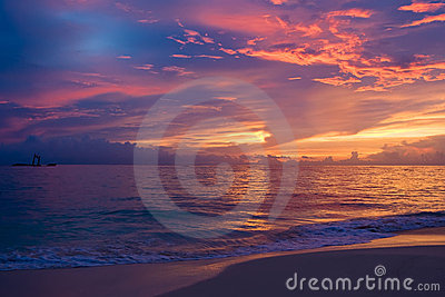 Yellow red pink blue sunset on the ocean