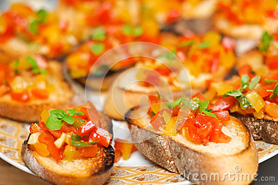 Yellow and red tomatoes bruschetta