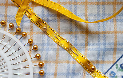 Yellow ribbon pinned to cotton cloth
