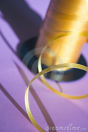 Yellow ribbon on purple Stock Photo