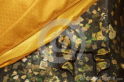 http://www.dreamstime.com/royalty-free-stock-image-yellow-robe-budda-statue-gold-leafs-image35145676