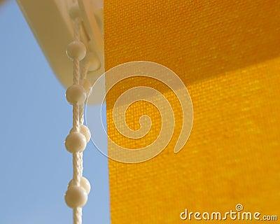 Yellow rollo shade