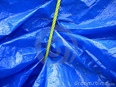 Yellow rope on blue tarpaulin