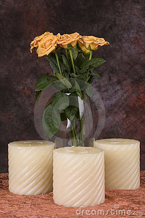 Yellow roses and candles