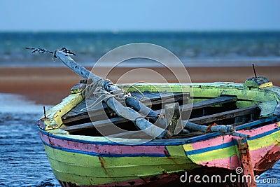 Yellow Sailing boat stranded