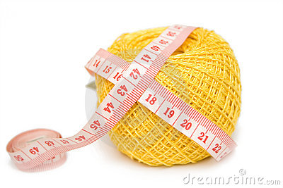 Yellow sewing clew and centimeter