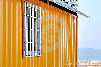 Yellow shed and sea view
