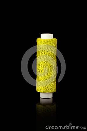Yellow spindle of yarn