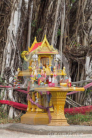 Free Yellow Spirit House With Flowers, Food, Incense, Candle And Jar Royalty Free Stock Image - 35703846