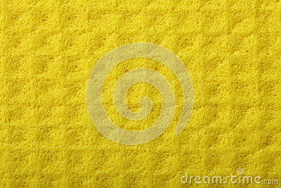Yellow sponge foam as background texture