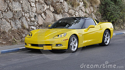 Yellow sports-car on mountain road