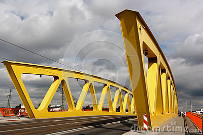 Yellow steel bridge, cloudy sky