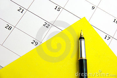 Yellow sticky note on calendar