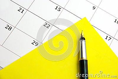 Yellow sticky note on calendar
