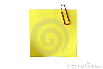 Yellow sticky paper with red clip. Isolated.