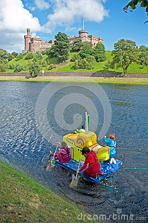 Yellow submarine raft  passing Inverness Castle ! Editorial Photography
